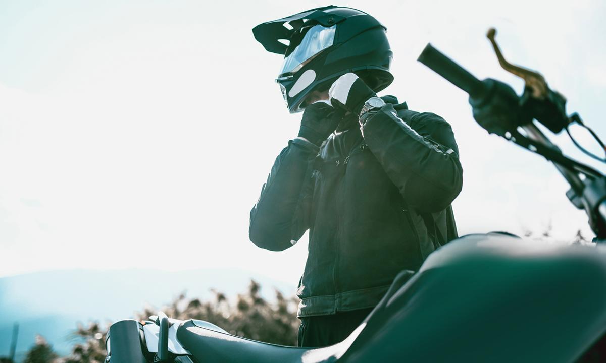 Man putting on motorcycle helmet