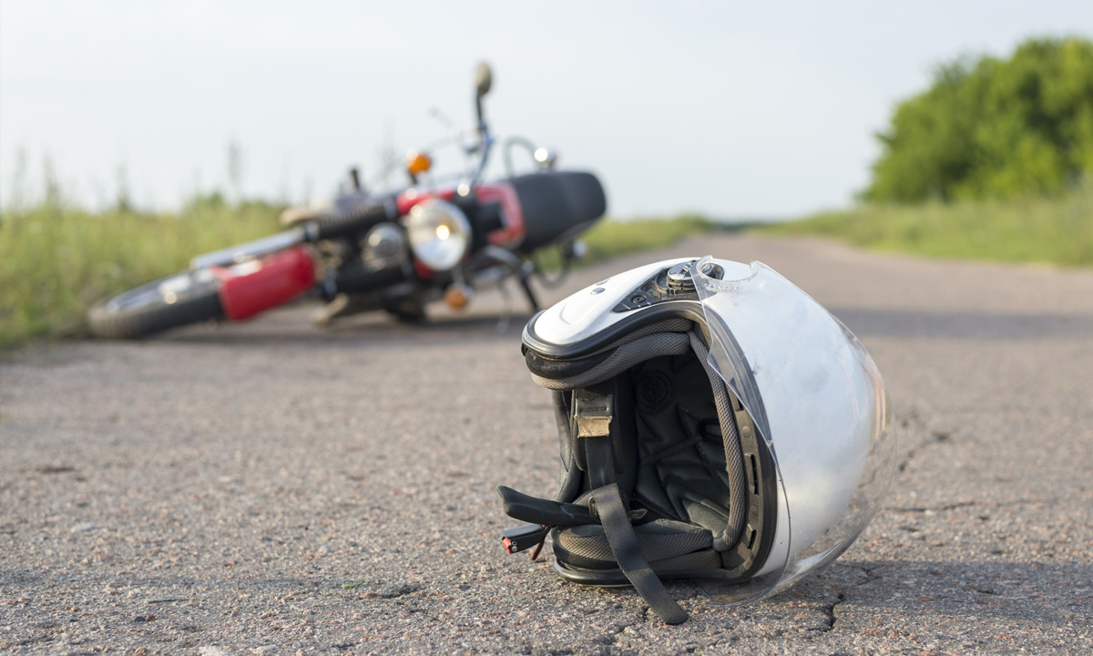 Motorbike helmet and bike on the ground
