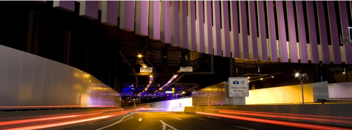 Speed camera warning sign at Airport Link tunnel entrance in Brisbane, Australia