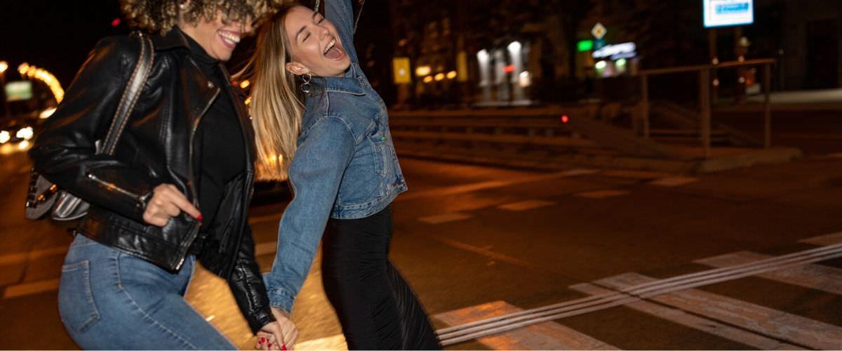 Happy drunk pedestrians crossing the road