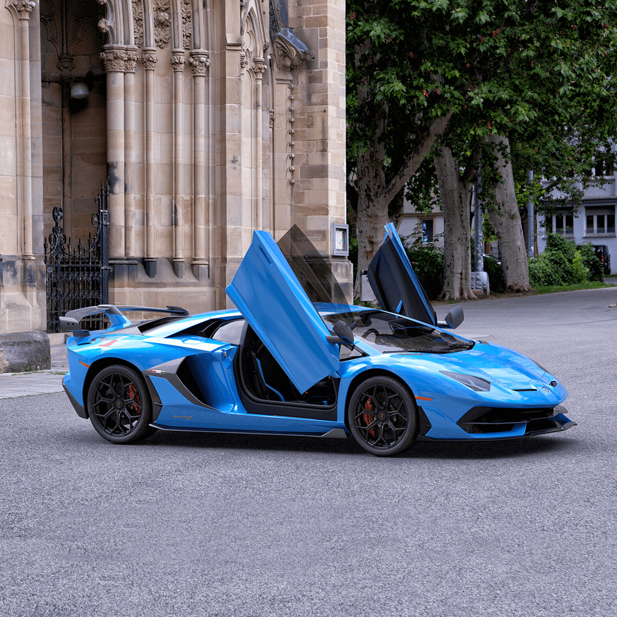 A render of a Lamborghini in Blue with the doors open outside a church