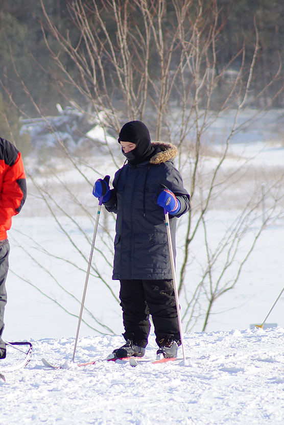 Young person cross-country skiing