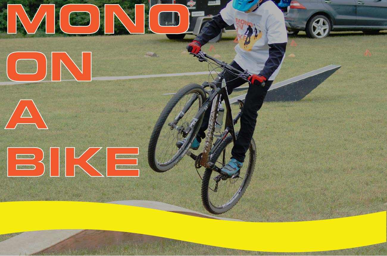 Mono On A Bike promo, showing a young man going over a jump with his bike