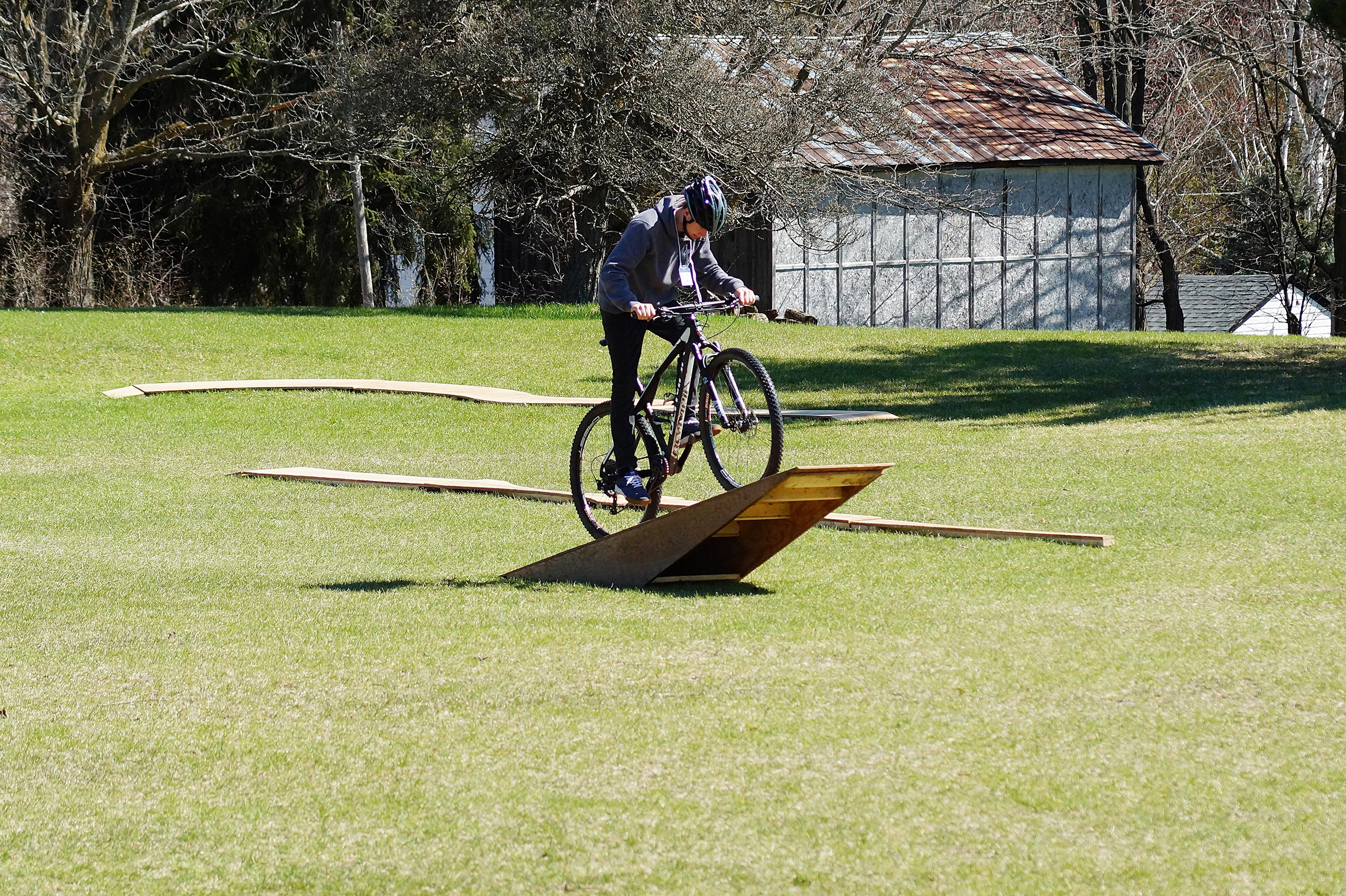 Cyclist ascending bicycle obstacle