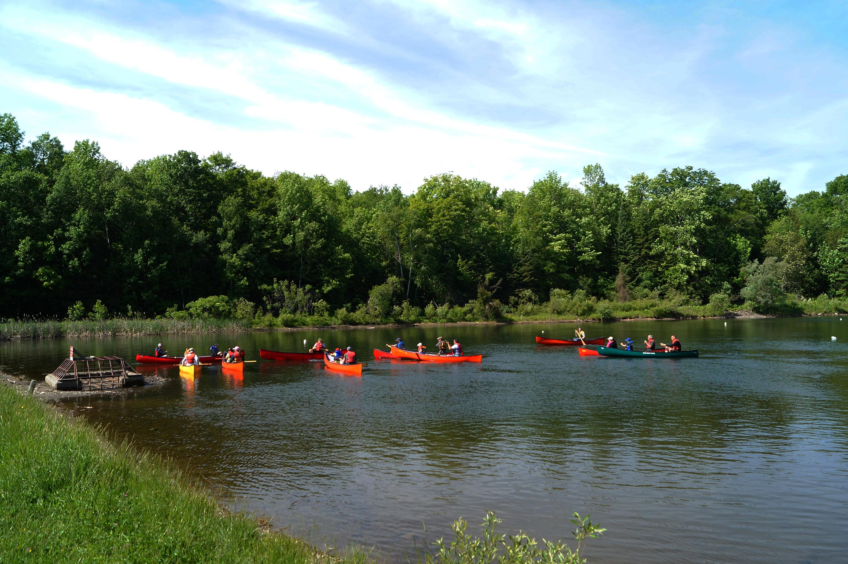 People participating in canoe instruction