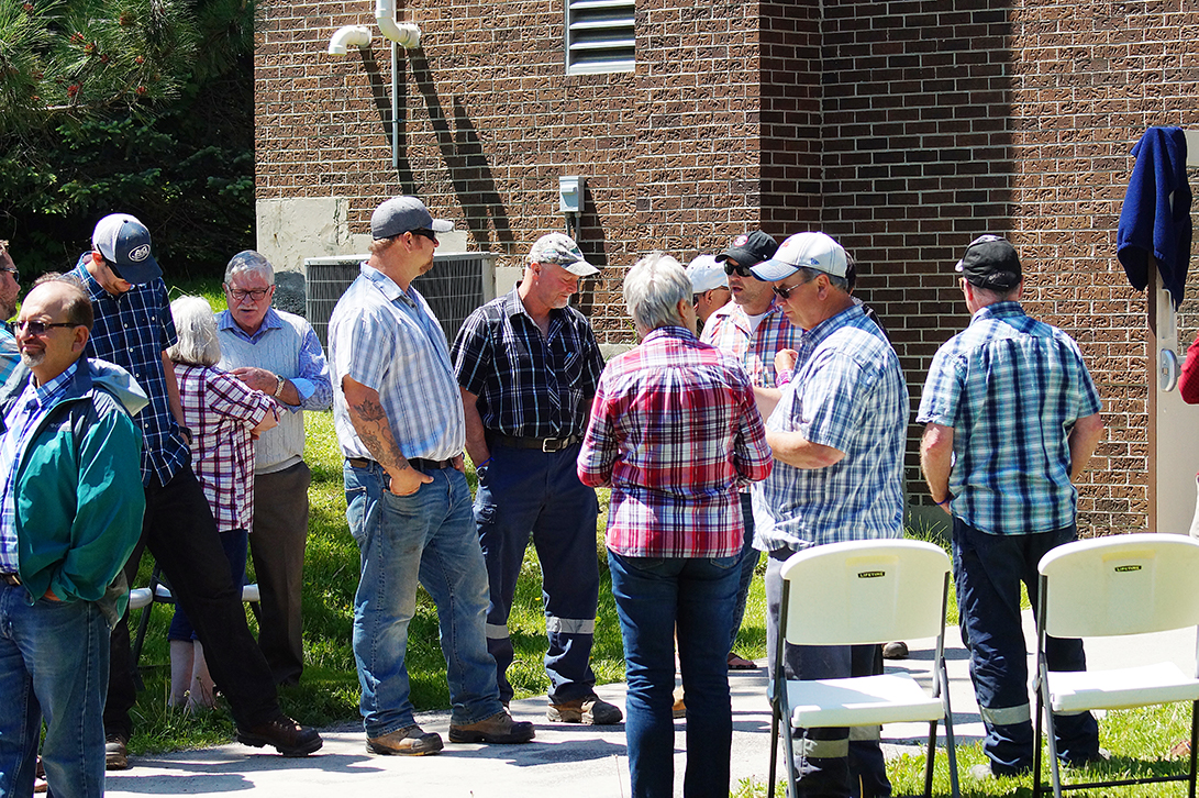 Group of staff and council members wearing plaid