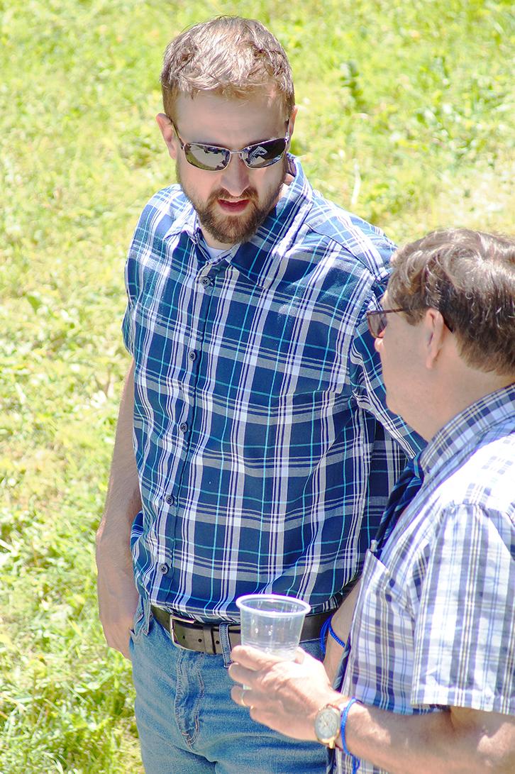 Two men in plaid talking