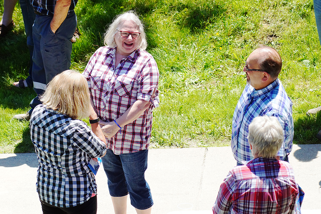 Group wearing plaid talking