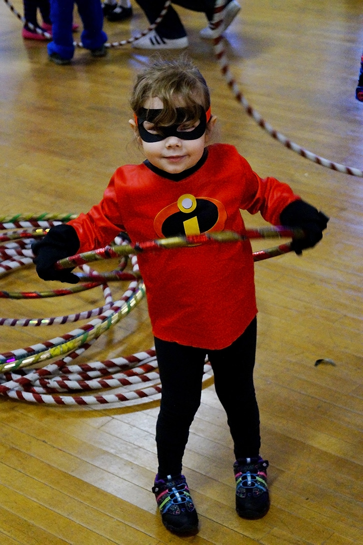Child in Halloween Custome with a hula hoop