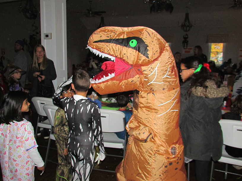 Child in a theropod costume
