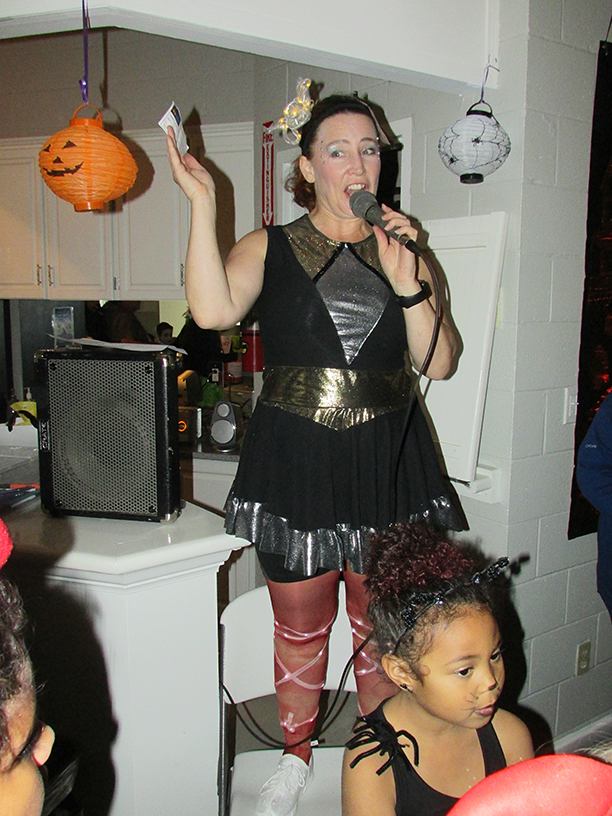 Woman in a costume with a microphone