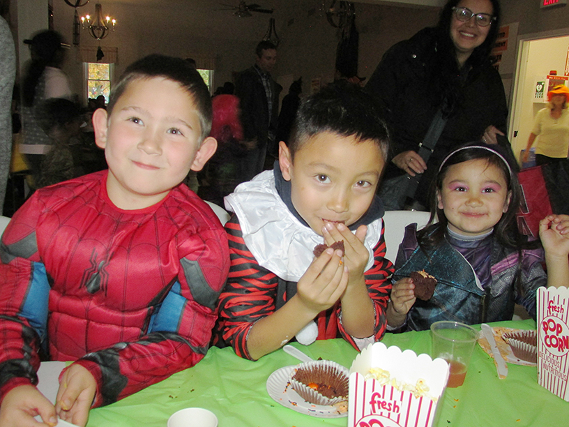 Three children in Halloween costumes