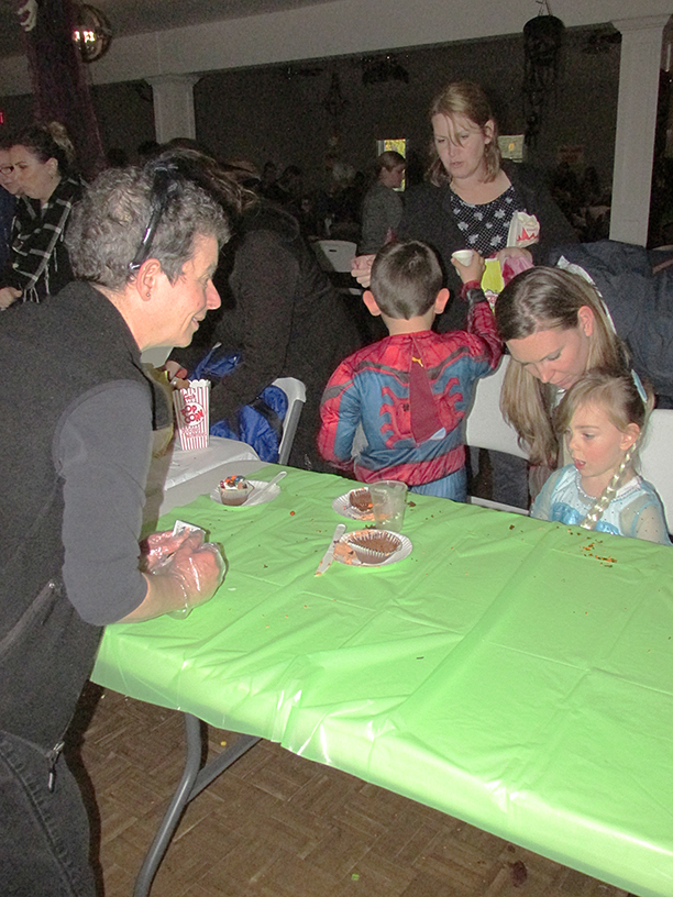 Child in a Halloween costume at a table