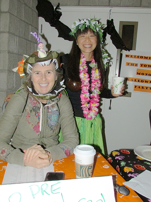 Two adults in Halloween costumes