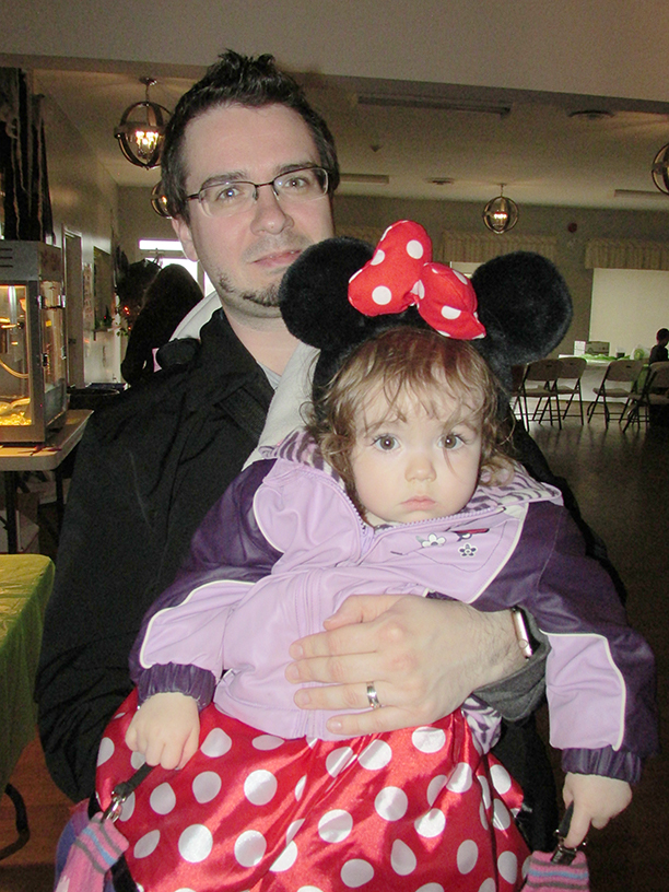 Adult holding child in a Minnie Mouse Halloween Costume