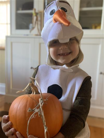 Child in Halloween costume: Olaf from the film Frozen
