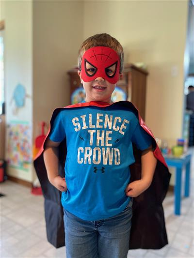 Child in Halloween costume: Spiderman with cape