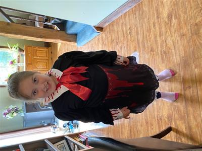 Child in Halloween costume, accented with fake blood