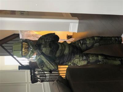 Child in Halloween costume: Master Chief from the Halo video games