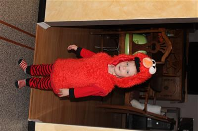 Child in Halloween costume: Elmo from the Sesame Street television show