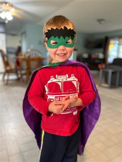 Child in Halloween costume: superhero