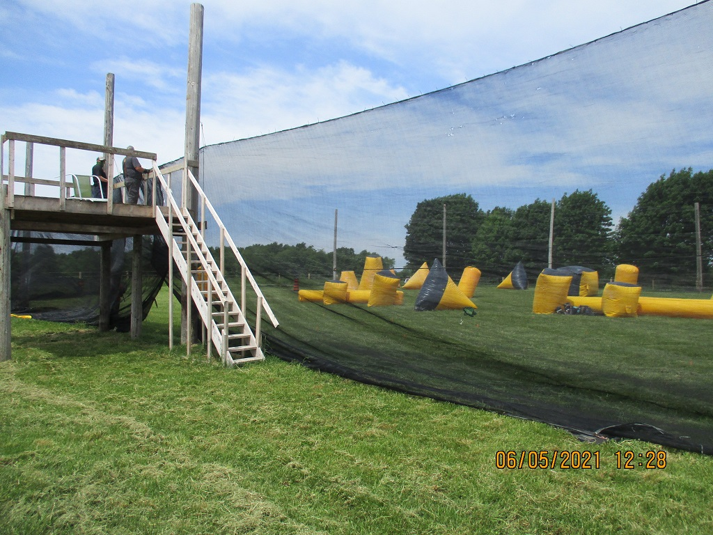 Paintball speedball arena with viewing loft. Shows inflatable obstacles