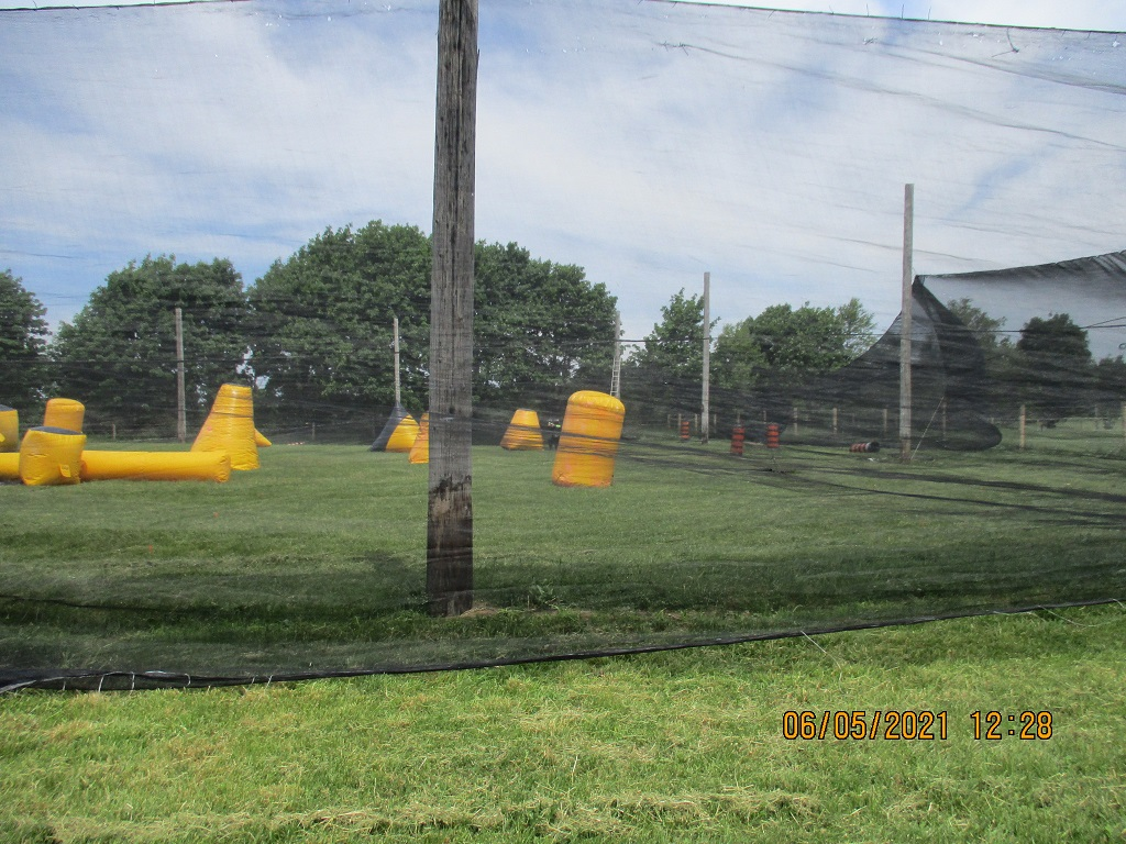 Mesh fencing around a speedball field