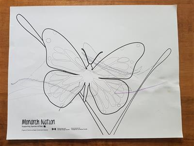 Butterfly colouring sheet completed by a one year old