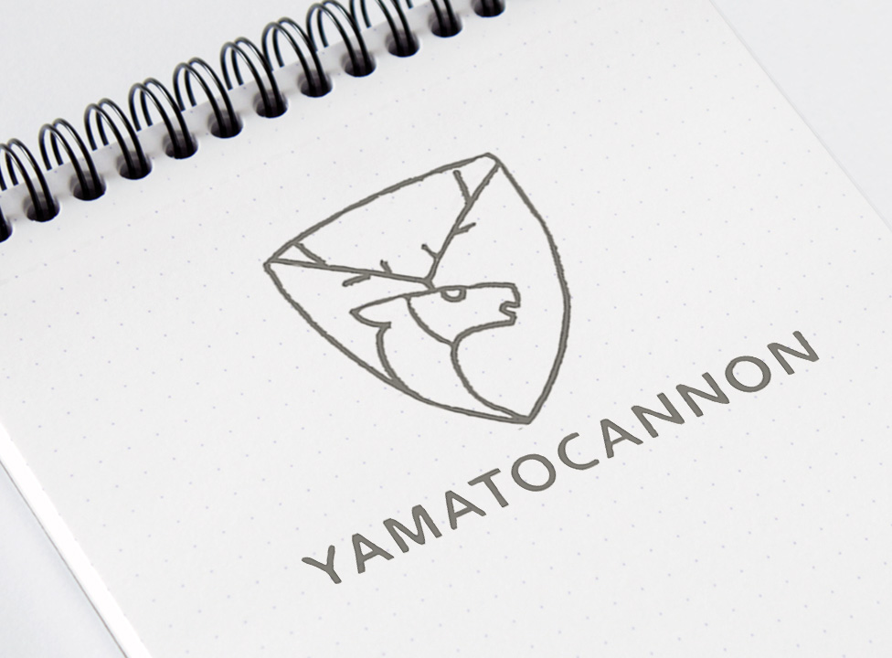 Sketch of the YamatoCannon logo formed by a deer