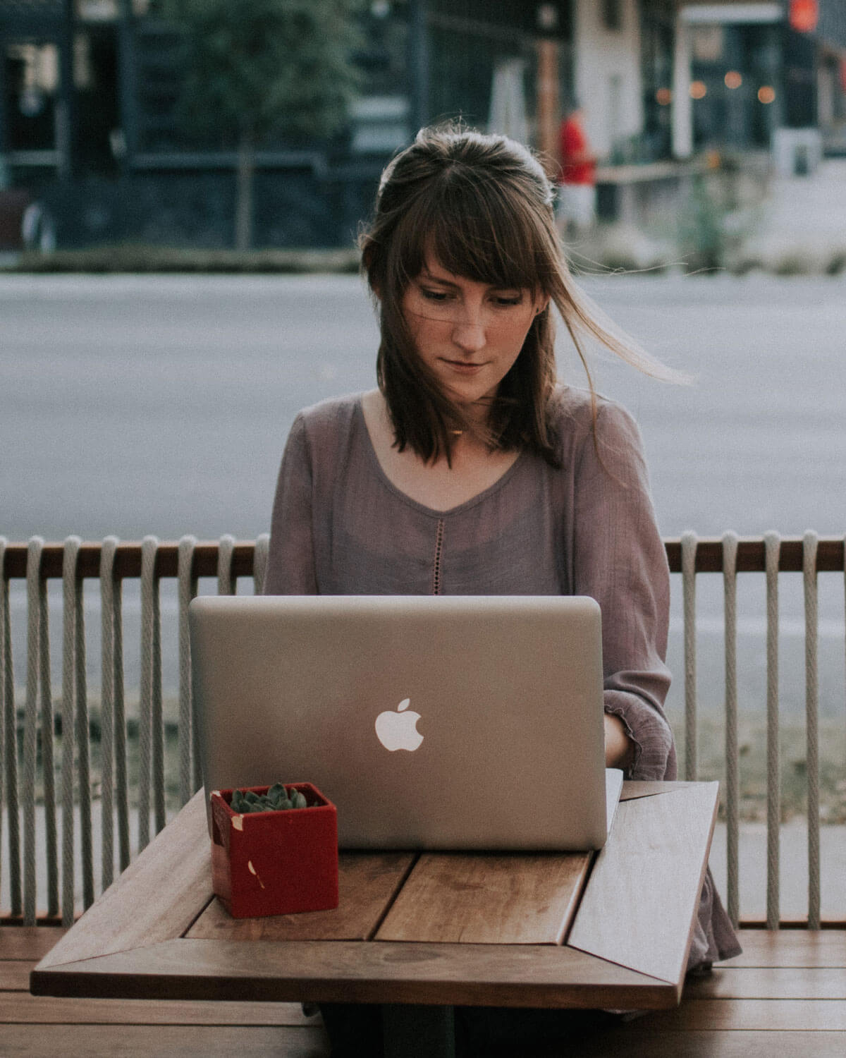 Woman at a Apple Macbook
