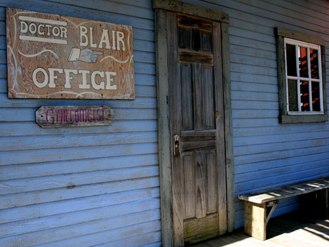 blue wall and rustic door with novelty signage