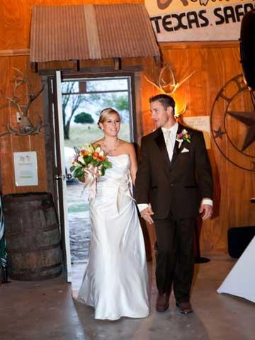 bride and groom walking into reception hall