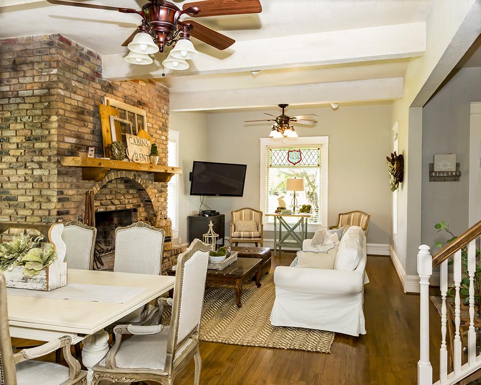 brick fireplace and lavish living area