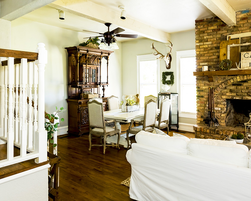 brick fireplace and dining area