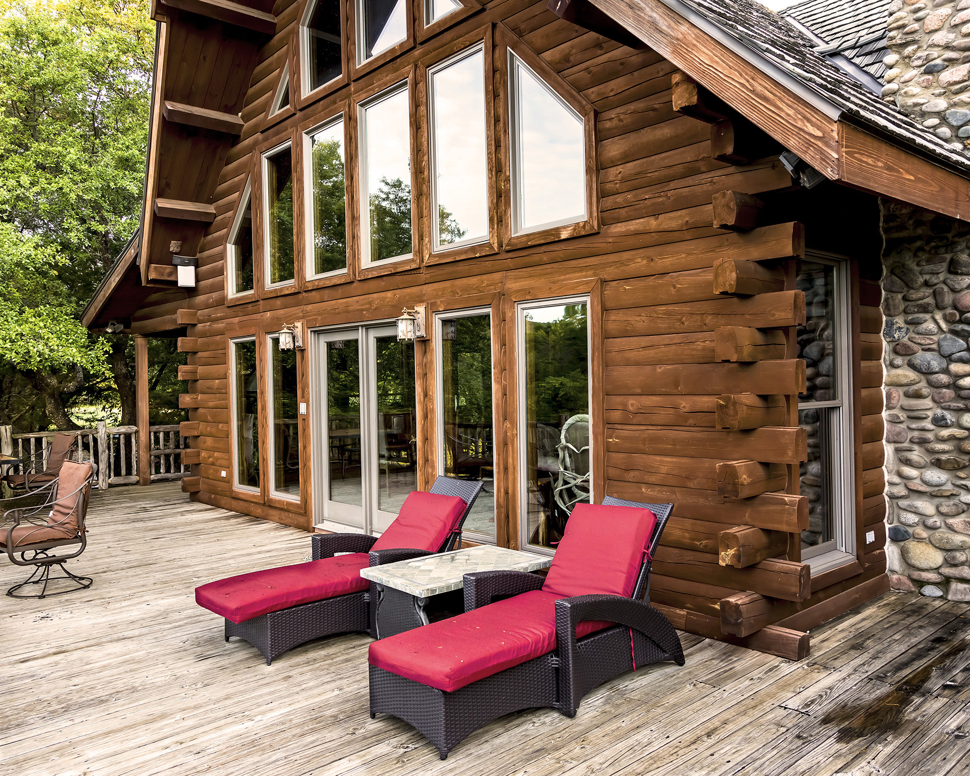 row of floor to ceiling windows on log cabin