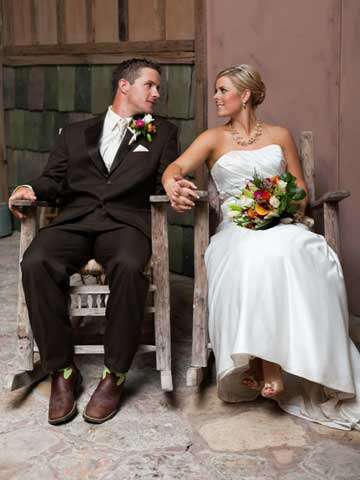 bride and groom sitting in rocking chairs