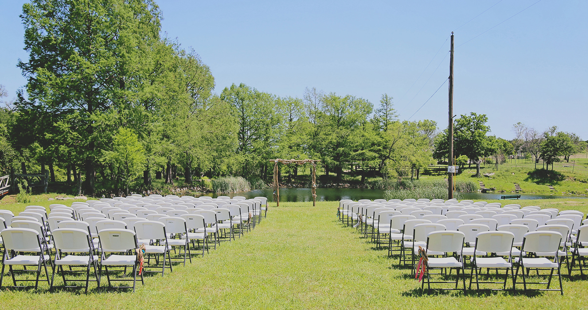 view of wedding spot and chairs from the end of the aisle