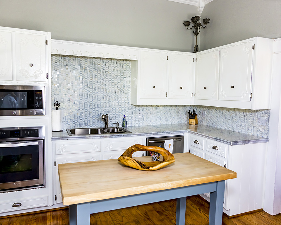kitchen with white cabinets and tile backsplash