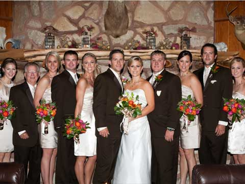 wedding party in front of fireplace