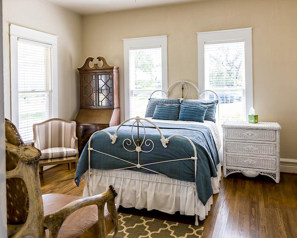 blue queen bed in guest room