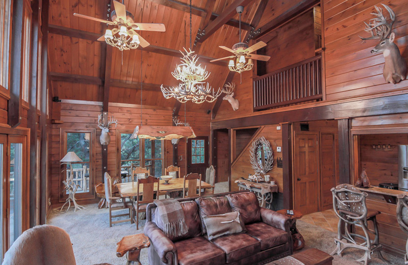 log cabin living area with antler chandeliers