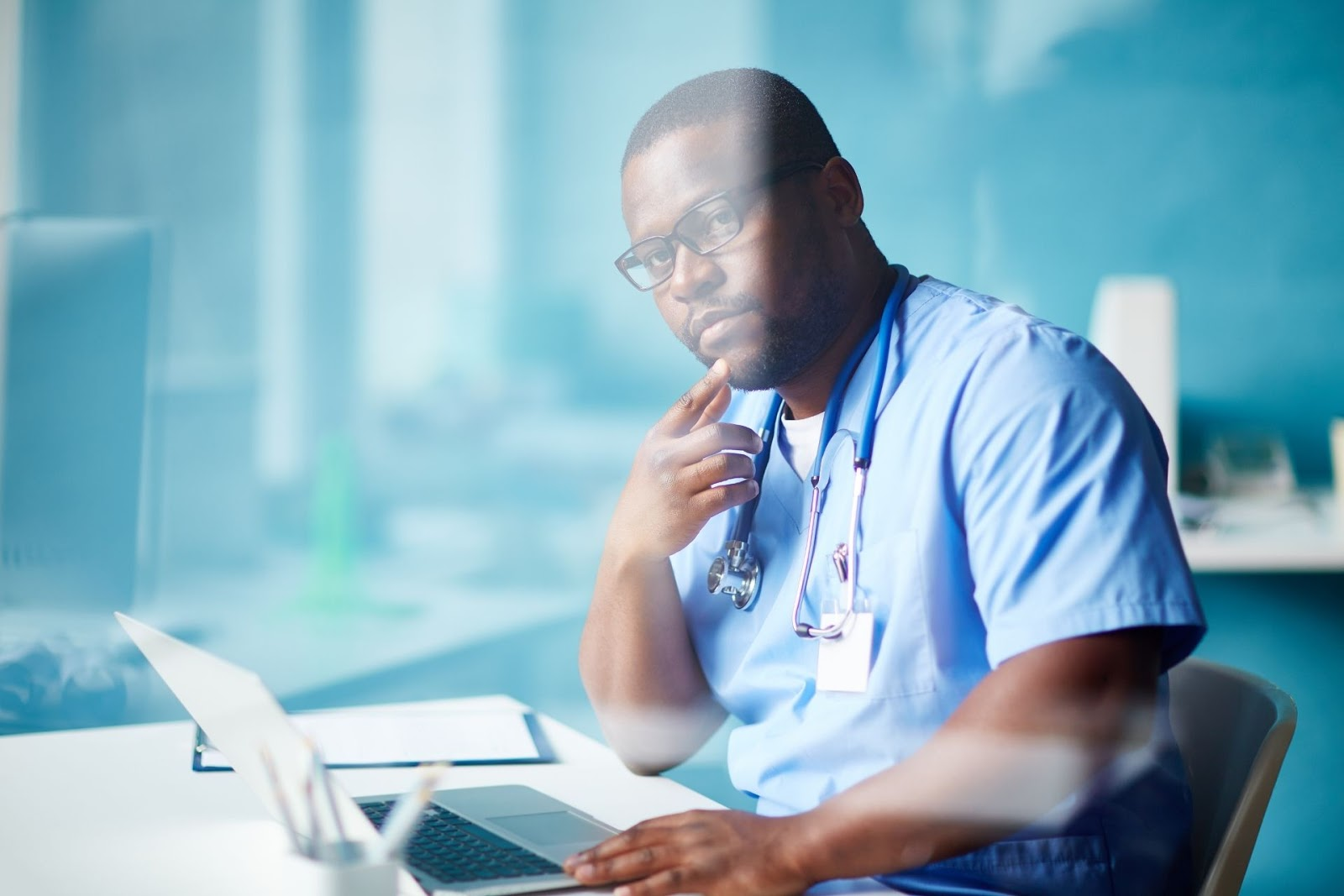 male doctor on laptop