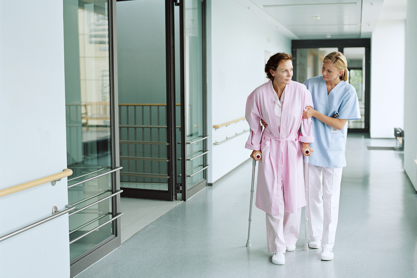 female medical staff helping patient
