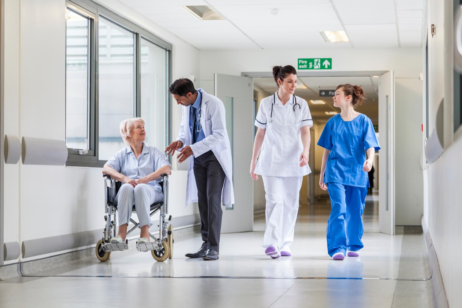 doctors and patient in hospital hallway