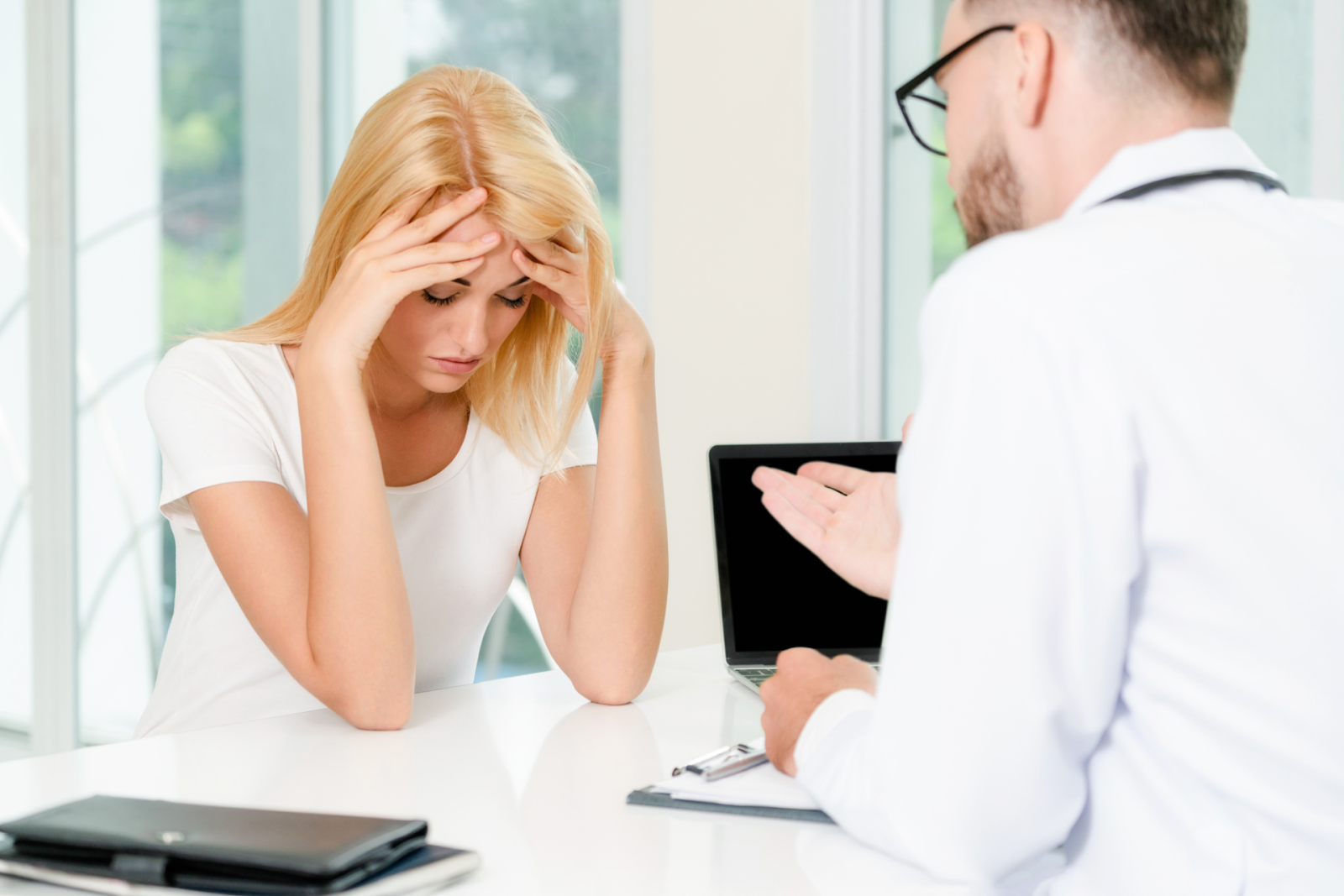 frustrated female patient and male doctor