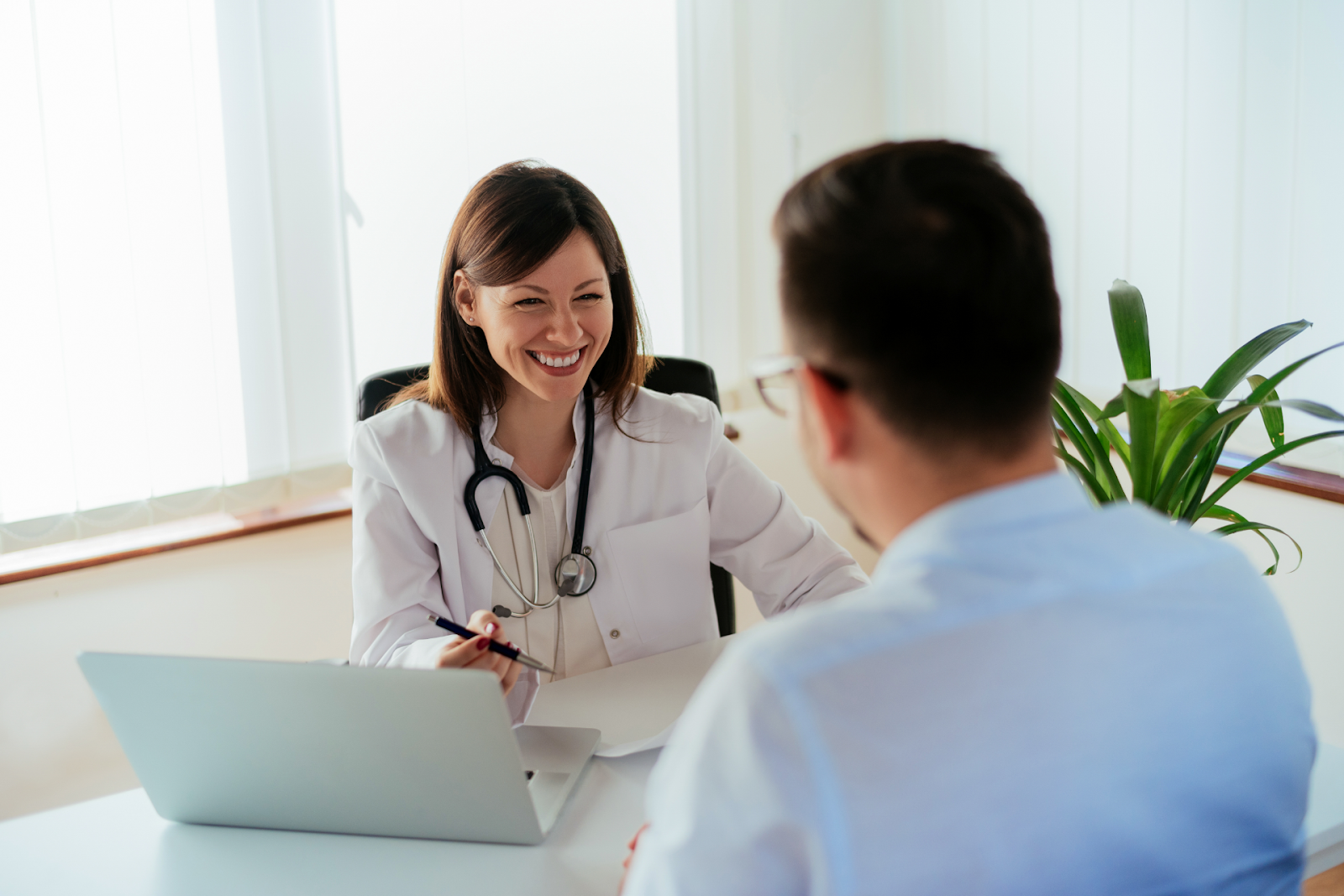 female physician talking to patient