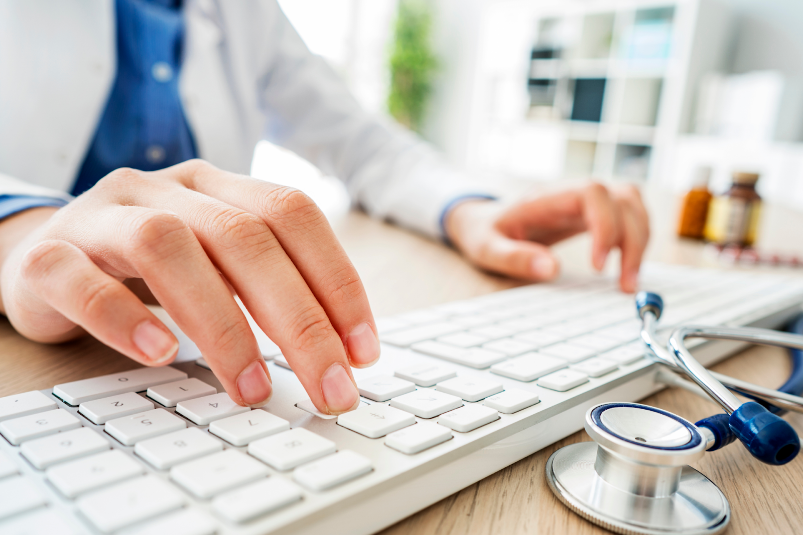 medical professional typing on computer