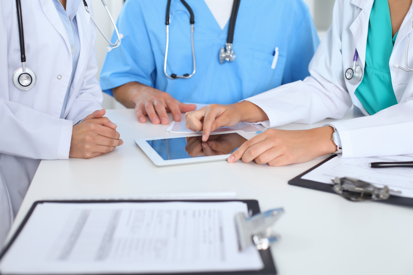 physicians looking at tablet
