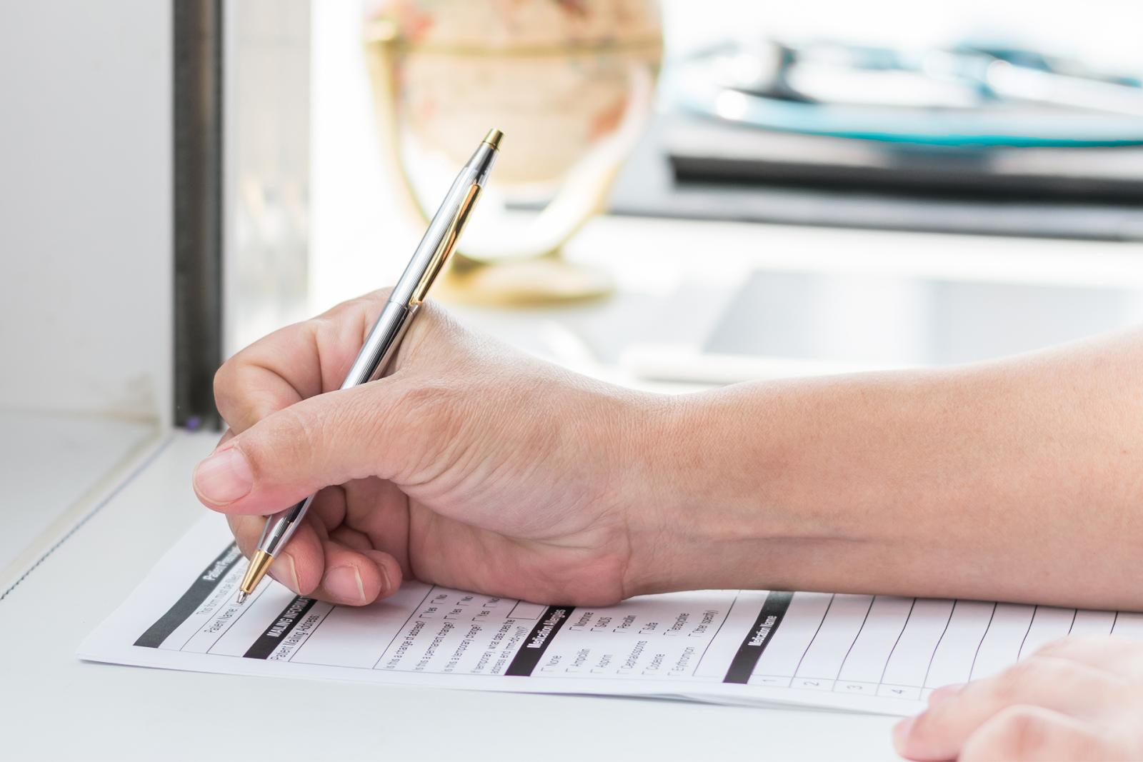 person writing health record