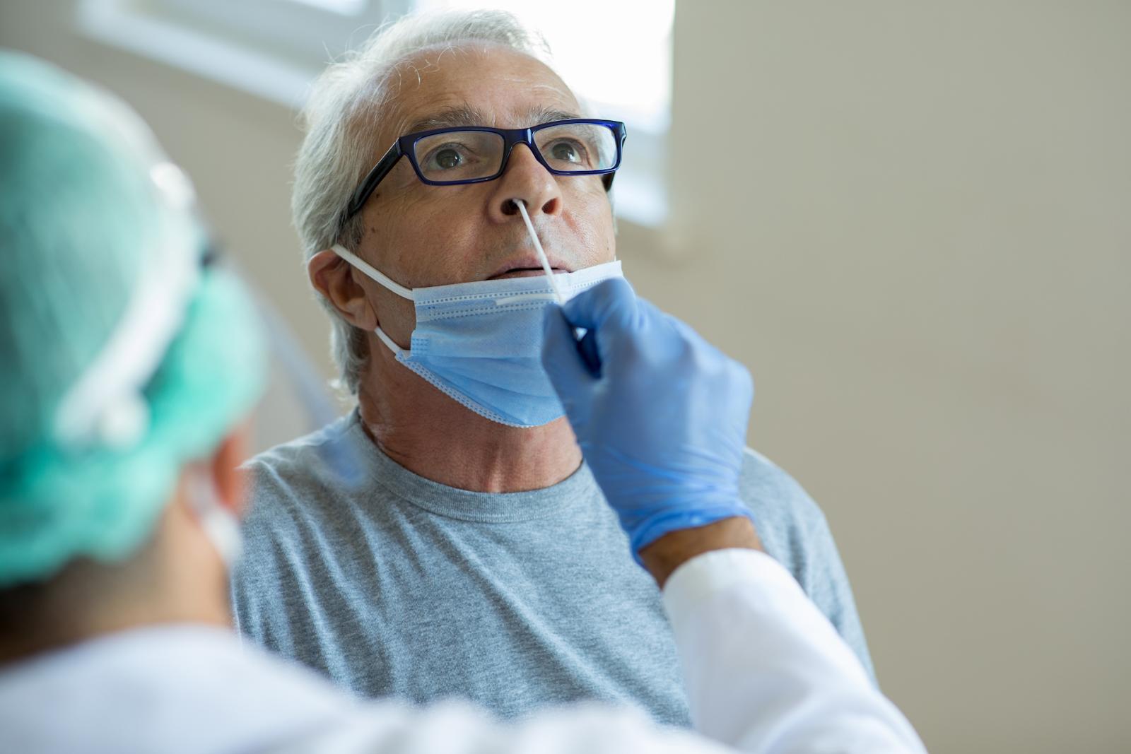 older man receiving covid test